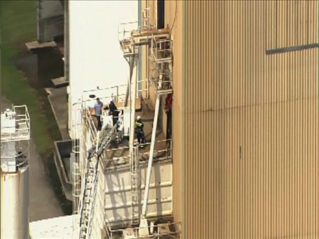 Authorities said a contract employee fell 60 feet into a grain elevator at H.J. Baker and Bro Inc. in Sanford Monday. Officials told ABC 11 the man was rescued around 4:45 p.m.  <span class=meta>(Photo&#47;WTVD Photo)</span>