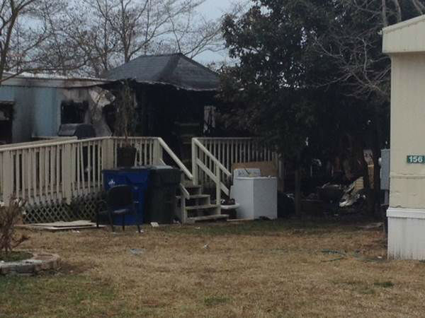 "<div class=""meta image-caption""><div class=""origin-logo origin-image ""><span></span></div><span class=""caption-text"">Neighbors told ABC11 one woman was burned trying to escape.  (WTVD Photo/ Tommy Harris)</span></div>"