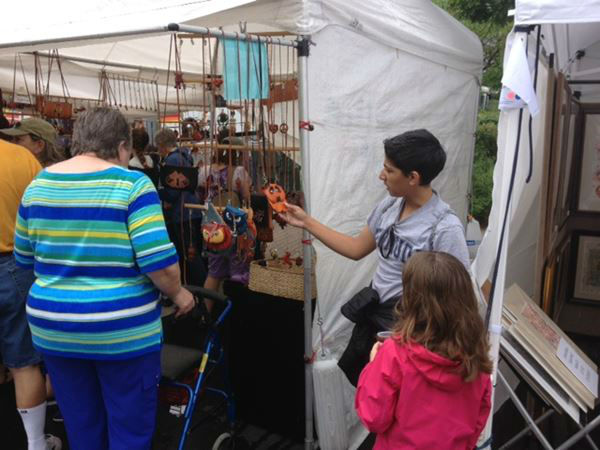"<div class=""meta ""><span class=""caption-text "">Wet weather put a damper on things at the Artsplosure event in downtown Raleigh Saturday (WTVD Photo/ Lori Denberg)</span></div>"