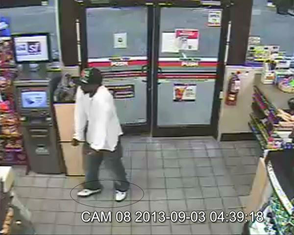 Surveillance photos from two convenience store robberies show the suspect wearing the same white sneakers to both <span class=meta>(WTVD Photo&#47; Fayetteville Police Department)</span>