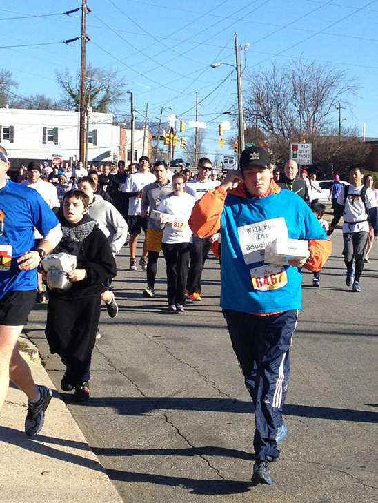 "<div class=""meta image-caption""><div class=""origin-logo origin-image ""><span></span></div><span class=""caption-text"">Each of the 8,000 racers at this year?s Krispy Kreme Challenge consumed 2,400 calories, 12 doughnuts, and ran five miles in one hour (WTVD Photo/ Lori Denberg)</span></div>"