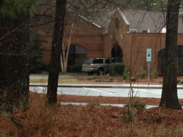 ABC11 was on the scene where an SUV crashed into Saint Luke The Evangelist Catholic Church Saturday morning. <span class=meta>(WTVD Photo&#47; Tommy Harris)</span>