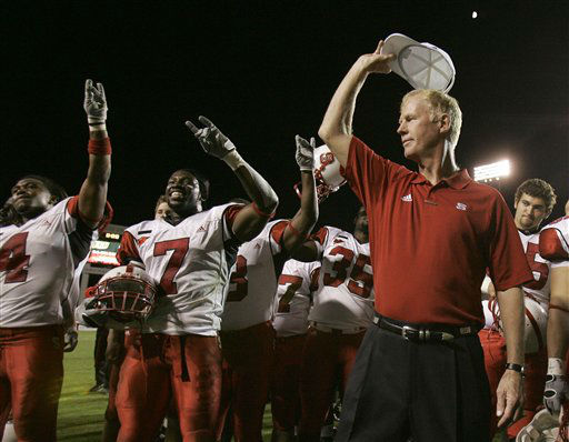**FILE** North Carolina State coach Tom O&#39;Brien, right, celebrates with DaJuan Morgan &#40;7&#41; and Javon Walker &#40;4&#41; following a college football game against East Carolina in Greenville, N.C., in this Oct. 20, 2007 file photo. Nearly everything went wrong for North Carolina State during a miserable start this season.  <span class=meta>(AP Photo&#47; Gerry Broome)</span>