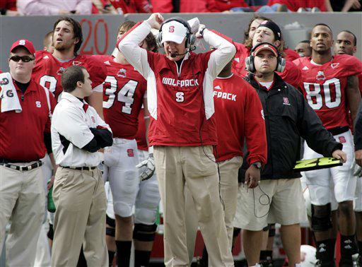 "<div class=""meta image-caption""><div class=""origin-logo origin-image ""><span></span></div><span class=""caption-text"">North Carolina State head football coach Tom O'Brien, center, reacts to a Clemson touchdown during the first half of an NCAA college football game in Raleigh, N.C., Saturday, Nov. 14, 2009.  Clemson won 42-23.   (AP Photo/ Jim R. Bounds)</span></div>"
