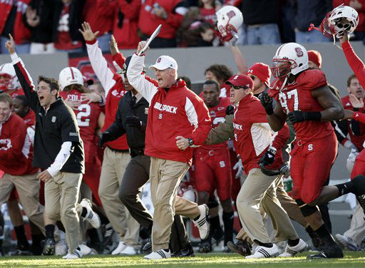 North Carolina State coach Tom O&#39;Brien, center, celebrates with the team following an NCAA college football game against North Carolina in Raleigh, N.C., Saturday, Nov. 28, 2009. North Carolina State won 28-27.  <span class=meta>(AP Photo&#47; Gerry Broome)</span>