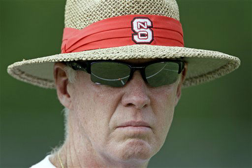 In this Tuesday, Aug. 3, 2010 photo, North Carolina State coach Tom O&#39;Brien watches his team during NCAA football practice in Raleigh, N.C.  <span class=meta>(AP Photo&#47; Gerry Broome)</span>