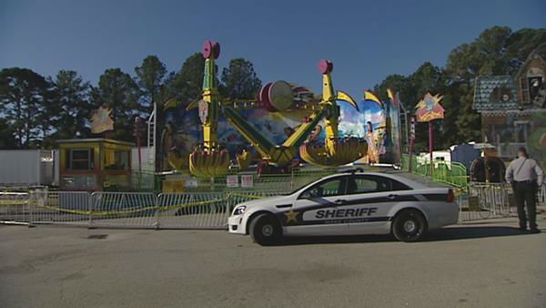 Crime scene taped roped off the Vortex ride Saturday morning at the N.C. State Fair.  <span class=meta>(WTVD Photo&#47; Aaron Asselin)</span>