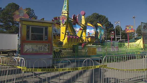 "<div class=""meta image-caption""><div class=""origin-logo origin-image ""><span></span></div><span class=""caption-text"">Crime scene taped roped off the Vortex ride Saturday morning at the N.C. State Fair.  (WTVD Photo/ Aaron Asselin)</span></div>"