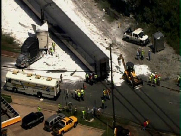 "<div class=""meta ""><span class=""caption-text "">The passenger train carrying 64 people crashed into a tractor-trailer carrying limestone Thursday afternoon in Jamestown. (WTVD Photo/ ABC11 Chopper HD)</span></div>"