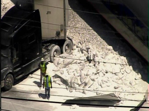 The passenger train carrying 64 people crashed into a tractor-trailer carrying limestone Thursday afternoon in Jamestown. <span class=meta>(WTVD Photo&#47; ABC11 Chopper HD)</span>