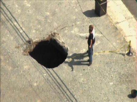 A sinkhole formed Tuesday afternoon near the...