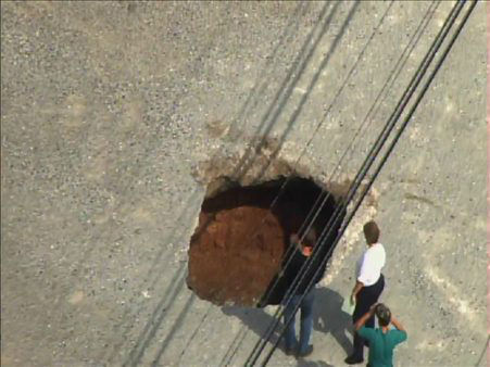 "<div class=""meta ""><span class=""caption-text "">A sinkhole formed Tuesday afternoon near the Bojangles in the 3500 block of Hillsborough Road. (WTVD Photo)</span></div>"