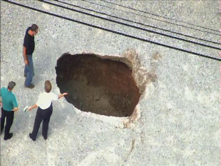 A sinkhole formed Tuesday afternoon near the Bojangles in the 3500 block of Hillsborough Road. <span class=meta>(WTVD Photo)</span>