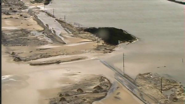Parts of N.C. Highway 12 remain underwater and damaged after Hurricane Sandy brushed the Outer Banks. <span class=meta>(WTVD Photo)</span>