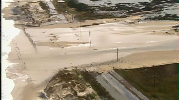 "<div class=""meta ""><span class=""caption-text "">Parts of N.C. Highway 12 remain underwater and damaged after Hurricane Sandy brushed the Outer Banks. (WTVD Photo)</span></div>"