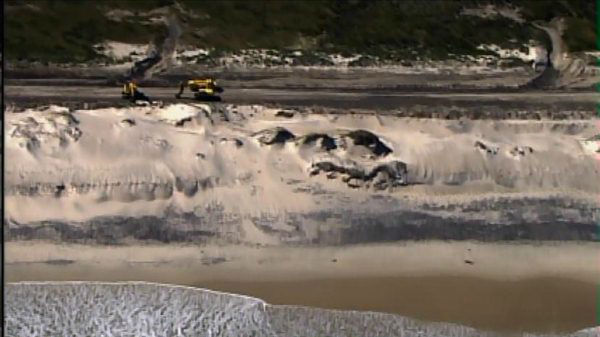 "<div class=""meta ""><span class=""caption-text "">Crews work to remove debris and sand from N.C. Highway 12 on the Outer Banks on Thursday, Nov. 1, 2012 (WTVD Photo)</span></div>"