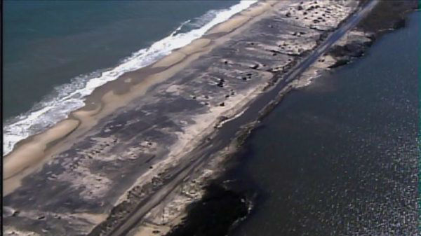 Crews work to remove debris and sand from N.C. Highway 12 on the Outer Banks on Thursday, Nov. 1, 2012 <span class=meta>(WTVD Photo)</span>