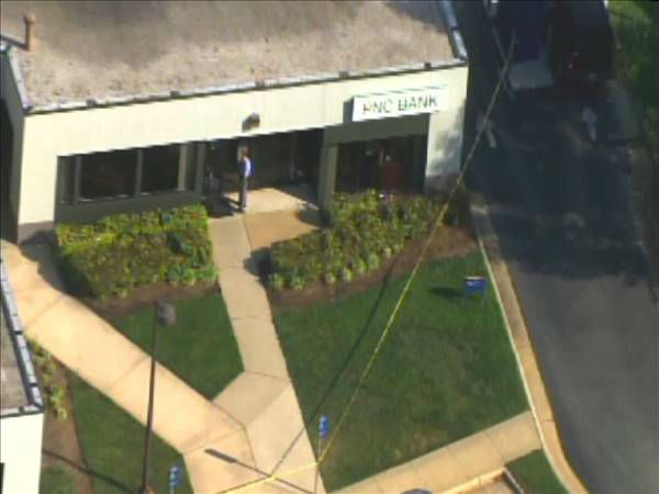 "<div class=""meta image-caption""><div class=""origin-logo origin-image ""><span></span></div><span class=""caption-text""> Police were on the scene of the PNC Bank in the 2400 block of Wycliff Road  (Photo/ABC11 Chopper HD)</span></div>"