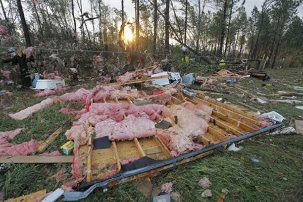 The remnants of a destroyed home lay across the road from it's foundation in Vale, N.C., Wednesday, Oct. 27, 2010 after powerful thunderstorms moved through the area. At least eleven people were hurt and eight homes damaged when a possible tornado touched down in Lincoln County in western North Carolina Tuesday evening, emergency officials said. (AP Photo/Chuck Burton)