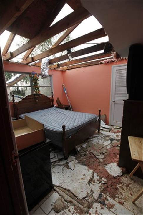 Pieces of the roof and ceiling lay on the floor of a bedroom in a damaged home in Vale, N.C., Wednesday, Oct. 27, 2010 after powerful thunderstorms moved through the area. At least eleven people were hurt and eight homes damaged when a possible tornado touched down in Lincoln County in western North Carolina Tuesday evening, emergency officials said. (AP Photo/Chuck Burton)