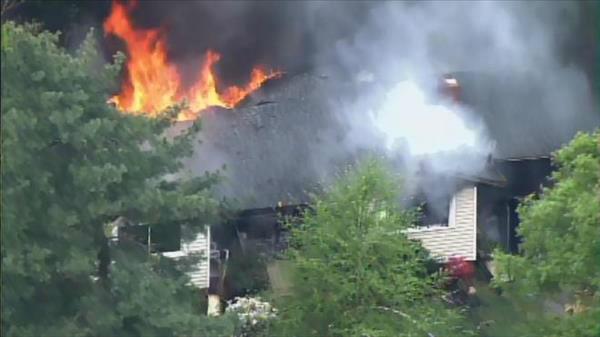 Flames seen shooting through the roof of a home on Barclay Drive in Raleigh Thursday morning. <span class=meta>(Photo&#47;Chopper11 HD)</span>