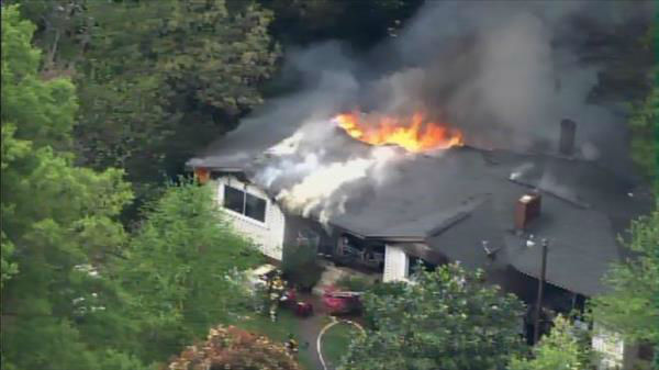 "<div class=""meta ""><span class=""caption-text "">Flames seen shooting through the roof of a home on Barclay Drive in Raleigh Thursday morning. (Photo/Chopper11 HD)</span></div>"