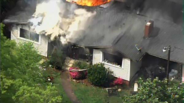 "<div class=""meta image-caption""><div class=""origin-logo origin-image ""><span></span></div><span class=""caption-text"">Flames seen shooting through the roof of a home on Barclay Drive in Raleigh Thursday morning. (Photo/Chopper11 HD)</span></div>"
