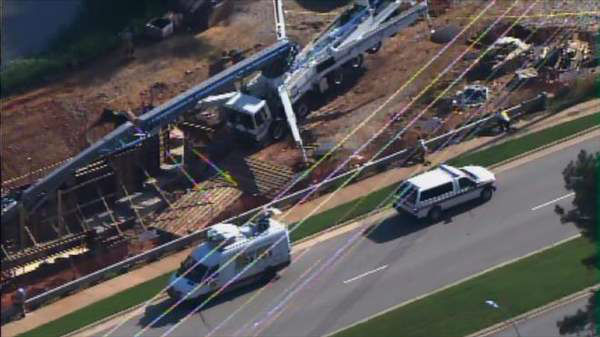 "<div class=""meta ""><span class=""caption-text "">Concrete pumping truck with long boom arm topples over at work site off Tryon Road in Cary Wednesday morning. (Photo/Chopper11 HD)</span></div>"