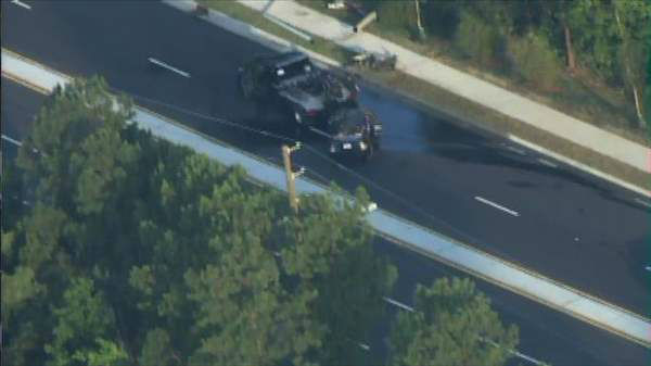 "<div class=""meta image-caption""><div class=""origin-logo origin-image ""><span></span></div><span class=""caption-text"">Authorities say car crashed into an utility pole on Falls of Neuse Road at Tabriz Point in Raleigh early Tuesday morning, knocking down power lines. (Photo/Chopper11 HD)</span></div>"