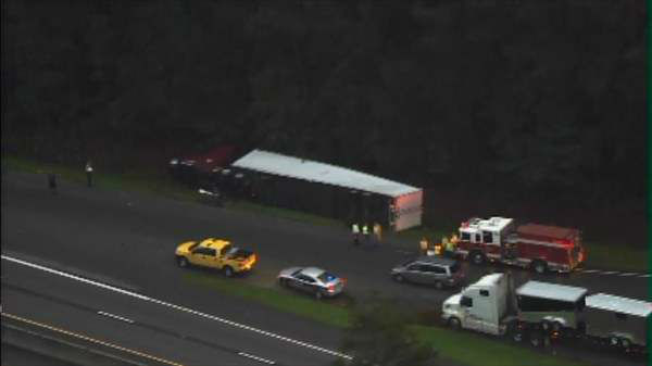 "<div class=""meta image-caption""><div class=""origin-logo origin-image ""><span></span></div><span class=""caption-text"">18-wheeler overturned on its side on Interstate 95 near milemarker 99 in Selma. (Photo/Chopper11 HD)</span></div>"
