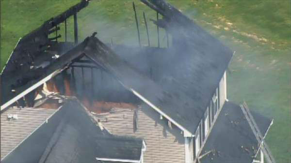 "<div class=""meta ""><span class=""caption-text "">Photos from Chopper11 HD of a house fire in southeastern Wake County Wednesday morning. Numerous fire departments were dispatched to the intersection of Singlepond Road and Rebarah Moor Drive near Angier as flames shot out from the attic of a two-story house. (Photo/Chopper11 HD)</span></div>"
