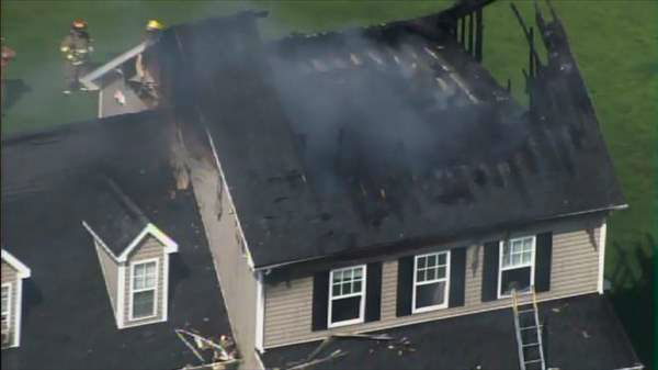 Photos from Chopper11 HD of a house fire in southeastern Wake County Wednesday morning. Numerous fire departments were dispatched to the intersection of Singlepond Road and Rebarah Moor Drive near Angier as flames shot out from the attic of a two-story house. <span class=meta>(Photo&#47;Chopper11 HD)</span>