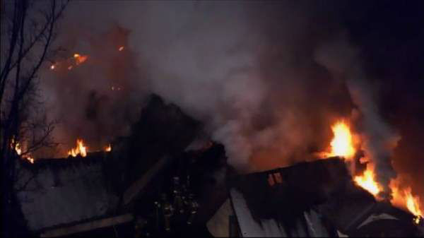 "<div class=""meta ""><span class=""caption-text "">Flames were seen shooting from roof of a home in the 4900 block of Birchleaf Drive near Penny Road in Raleigh Thursday morning. (Photo/Chopper11 HD)</span></div>"