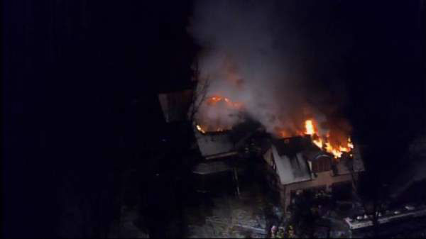 Flames were seen shooting from roof of a home in the 4900 block of Birchleaf Drive near Penny Road in Raleigh Thursday morning. <span class=meta>(Photo&#47;Chopper11 HD)</span>