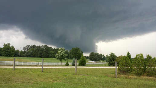 "<div class=""meta ""><span class=""caption-text "">A possible tornado forming between Wake Forest & Highway 98. Taken on U.S. Highway 401.  (WTVD Photo/ UReport Photo)</span></div>"