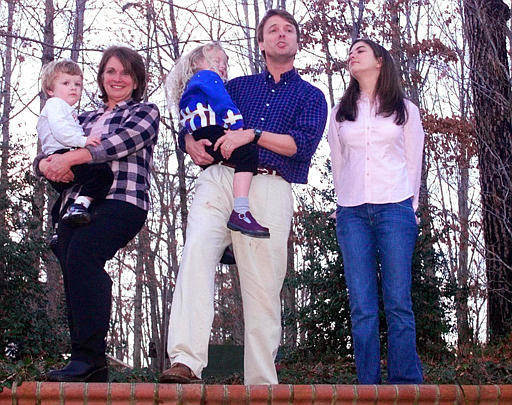 Sen. John Edwards, D-N.C., holding his daughter Emma, 4, stands with his wife Elizabeth, holding their son Jack, 2, and his daughter Cate, 19, at left, as he begins to tell a crowd gathered in the backyard of his home in Raleigh, N.C., Wednesday, Jan 1, 2003, about his plans to form an exploratory committee to run for president.  <span class=meta>(AP Photo&#47; KARL DEBLAKER)</span>
