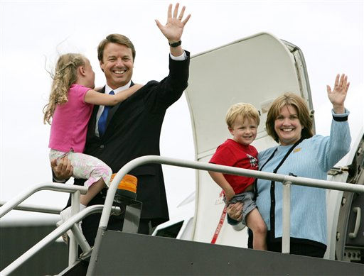Then-Sen. John Edwards, D-N.C., left, holds his daughter Emma Claire, 6, and his wife Elizabeth, holds their son Jack, 4, as they depart Edwards&#39; campaign plane in Boston in this July 27, 2004 file photo.   <span class=meta>(AP Photo&#47; Steven Senne)</span>