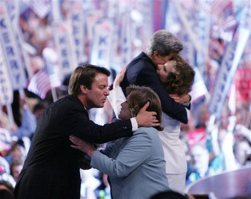 Democratic vice presidential nominee John Edwards prepares to kiss his wife Elizabeth as  presidential nominee John Kerry embraces his wife Teresa Heinz Kerry at the Democratic National Convention at the FleetCenter in Boston Thursday, July 29, 2004.  <span class=meta>(AP Photo&#47; STEVEN SENNE)</span>