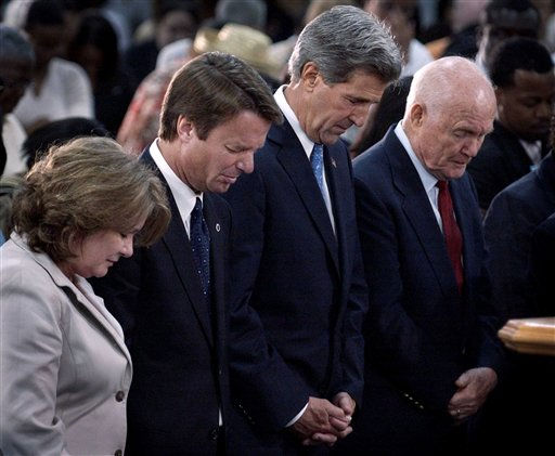 From lef to right, Elizabeth Edwards, Sen. John Edwards, D-N.C., Sen. John Kerry, D-Mass., and former astronaut and senator John Glenn, pray during a service at the Greater Grace Temple Church in Springfield, Ohio on Sunday, Aug. 1, 2004.  <span class=meta>(AP Photo&#47; LAURA RAUCH)</span>