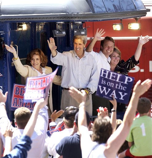 The train carrying Democratic presidential nominee Sen. John Kerry, D-Mass., second left, his wife Teresa, left, vice presidential nominee Sen. John Edwards, D-N.C., second right, and his wife Elizabeth, right, rolls out of historic Union Station in St. Louis past cheering supporters after a rally in St. Louis, Thursday, Aug. 5, 2004.  <span class=meta>(AP Photo&#47; CHARLES REX ARBOGAST)</span>