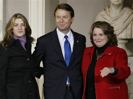 Sen. John Edwards with his wife Elizabeth and their daughter Cate look to supporters following Sen. John Kerry&#39;s concession speech at Faneuil Hall in Boston on Wednesday, Nov. 3, 2004.  It was reported that Elizbeth Edwards was diagnosed with breast cancer the day of the consession.  <span class=meta>(AP Photo&#47; AMY SANCETTA)</span>