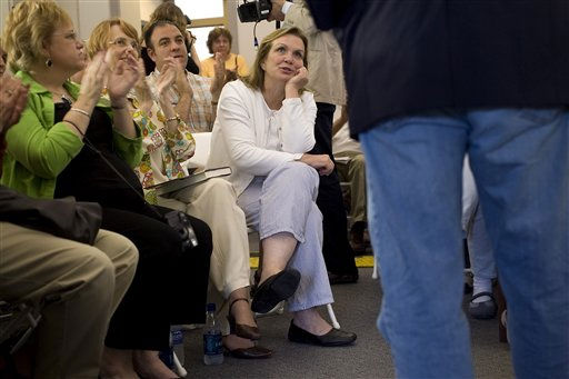 "<div class=""meta ""><span class=""caption-text "">Elizabeth Edwards, left, reminds her husband, Democratic presidential hopeful John Edwards, about something he forgot to mention when he answered a question at the Vinton Public Library in Vinton, Iowa, Saturday, May 26, 2007. Edwards, a former North Carolina senator, was making a weekend-long swing through Iowa to outline his policy called the ""sacred contract."" It aimed to offer better services and benefits for veterans, returning troops and their families.  (AP Photo/ David Lienemann)</span></div>"