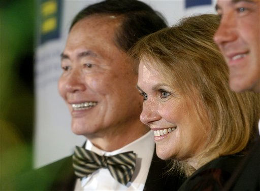 Elizabeth Edwards, wife of Democratic presidential hopeful John Edwards, attends a gala for the Human Rights Campaign on Saturday, July 14, 2007, in San Francisco. At left is actor George Takei who announced he is gay in 2005. During her speech, Edwards reiterated her support for gay marriage. <span class=meta>(AP Photo&#47; Noah Berger)</span>