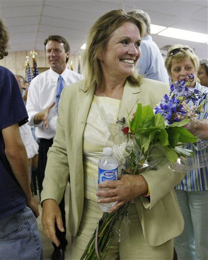 Democratic presidential hopeful, former Sen. John Edwards, D-N.C., rear left, and his wife Elizabeth, arrive for a town-hall style meeting at the Steelworkers Union Hall in Georgetown, S.C., Tuesday, July 24, 2007.  <span class=meta>(AP Photo&#47; CHARLES DHARAPAK)</span>