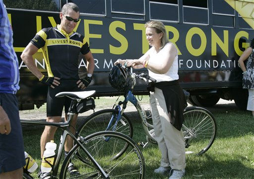 "<div class=""meta image-caption""><div class=""origin-logo origin-image ""><span></span></div><span class=""caption-text"">Seven-time Tour de France winner Lance Armstrong, left, talks with Elizabeth Edwards, wife of Democratic presidential hopeful, former North Carolina Sen. John Edwards, prior to riding in the Des Moines Register's Annual Great Bike Ride Across Iowa, Wednesday, July 25, 2007, near Dumont, Iowa.   (AP Photo/ Charlie Neibergall)</span></div>"