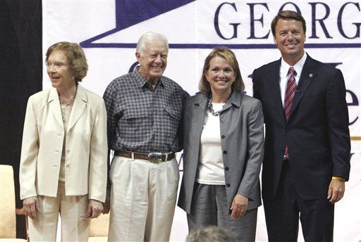 Former first lady Rosalynn Carter and former President Jimmy Carter, left, pose on stage with Elizabeth Edwards and presidential hopeful John Edwards at Georgia  Southwestern State College in Americus, Ga., Wednesday, Aug. 29, 2007.  <span class=meta>(AP Photo&#47; Gene Blythe)</span>