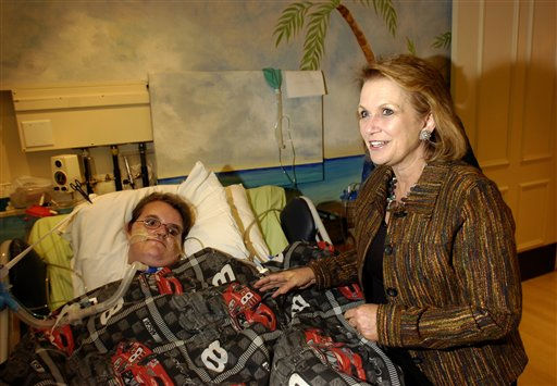 In this photo released by George Mark Children?s House, Elizabeth Edwards, wife of Democratic presidential hopeful John Edwards, meets Brandan Stark during a visit to the George Mark Children&#39;s House, a non-profit hospice for terminally ill children, on Saturday, Sept. 29, 2007, in San Leandro, Calif. Edwards, who?s son died in a 1996 car accident, visited patients and spoke about the need for communities such as George Mark Children?s House.  <span class=meta>(AP Photo&#47; George Mark Children?s House, Noah Berger)</span>