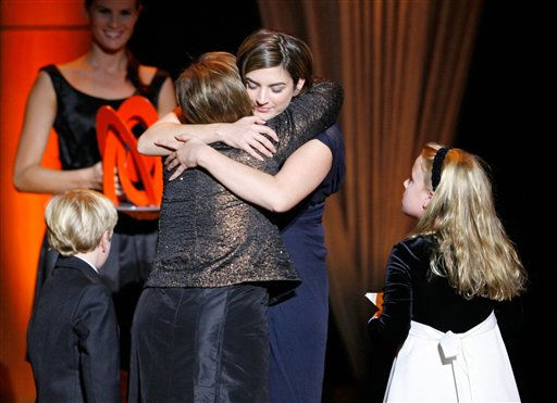Cate Edwards, center, hugs her mother Elizabeth Edwards, wife of Democratic presidential hopeful Sen. John Edwards, D-N.C., and recipient of a Woman of the Year award, as Jack Edwards, left, and Emma Claire Edwards, right, look on at the 18th Annual Glamour Women of the Year awards at Lincoln Center&#39;s Avery Fisher Hall Monday, Nov. 5, 2007 in New York.  <span class=meta>(AP Photo&#47; Jason DeCrow)</span>