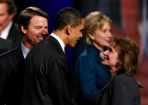 Democratic presidential hopeful Sen. Barack Obama, D-Ill.,center,  greets Elizabeth Edwards, wife of former Sen. John Edwards, D-N.C., left, before the Des Moines Register Democratic Presidential Debate in Johnston, Iowa, Thursday, Dec.13, 2007. Pictured in background, Democratic presidential hopeful Sen. Hillary Rodham Clinton, D-N.Y.  <span class=meta>(AP Photo&#47; Charlie Neibergall)</span>