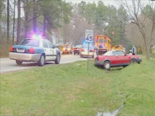 Three students were on a bus Monday morning when it was involved in a crash with a car on Lead Mine Road at Lakehaven Drive. No injuries were reported, but both vehicles suffered damage. <span class=meta>(WTVD Photo)</span>